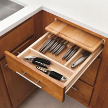 Aristokraft knife organization drawer with pullout cutting board